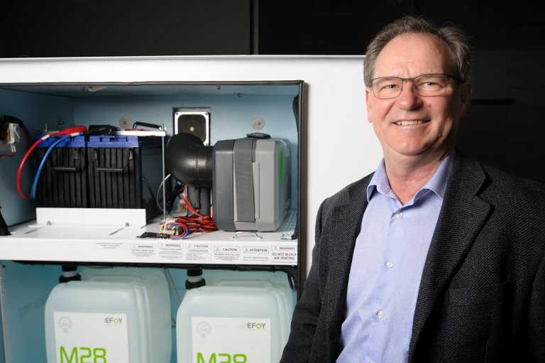 Martin Curtis, president of SFC Energy Canada, standing in front of EFOY fuel cell