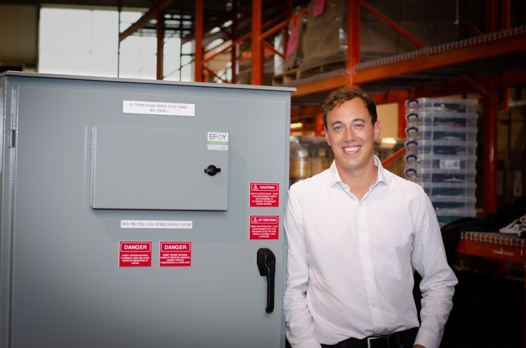 Dustin Hullman of Simark Controls standing in front of an EFOY Pro cabinet